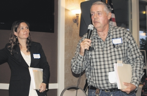 Matthew Weaver/Capital Press Attorney Toni Meacham looks to rancher Joe Lemire during an update on Lemire's upcoming case before the state supreme court at the Cattle Producers of Washington annual meeting Oct. 26 in Moses Lake, Wash.